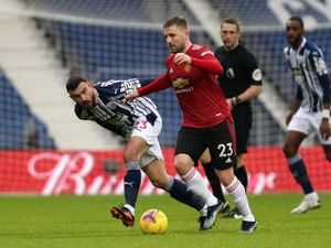 Robert Snodgrass of West Bromwich Albion and Luke Shaw of Manchester United.