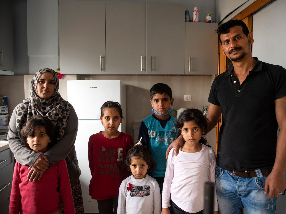 Abdul Salam Al Khawien and his wife Kariman with their children at their apartment in Thessaloniki, Greece