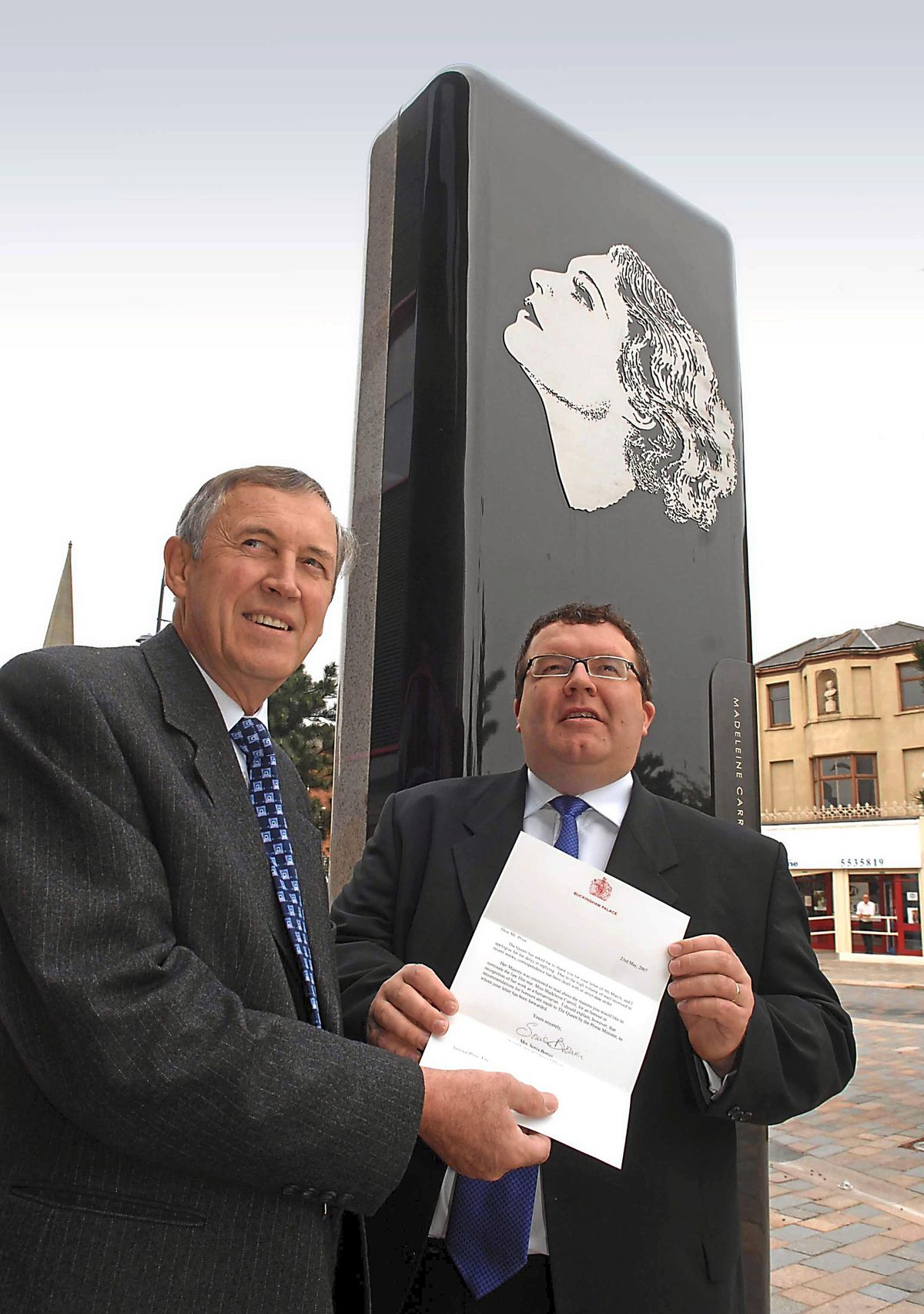 Historian Terry Price and former MP Tom Watson at the monument to Madeleine Carroll in West Bromwich town centre