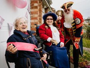 Lina Cori was surprised for her 100th birthday by family, neighbourd and Shrewsbury town crier Martin Wood and his wife Sue