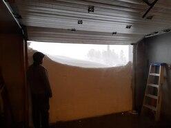 Canadians open garage door on record-breaking snowfall as emergency called