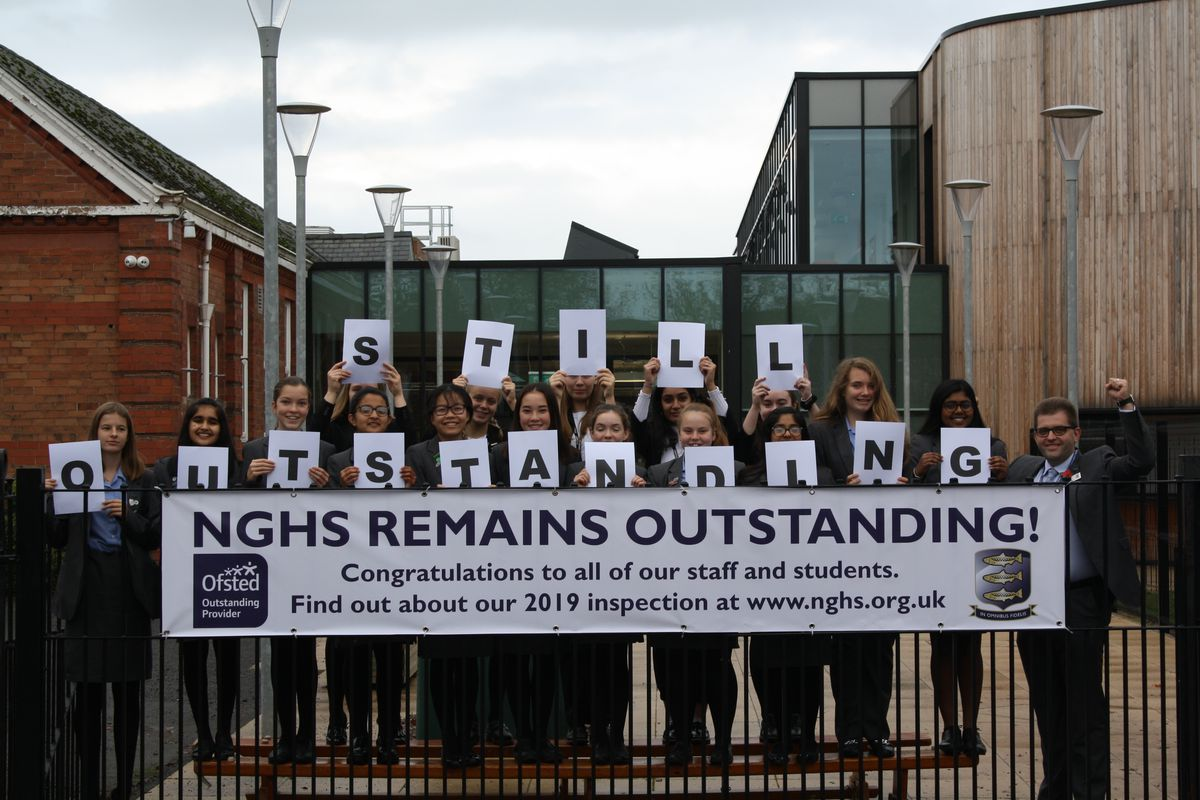 Students celebrating the results of their 'outstanding' Ofsted inspection
