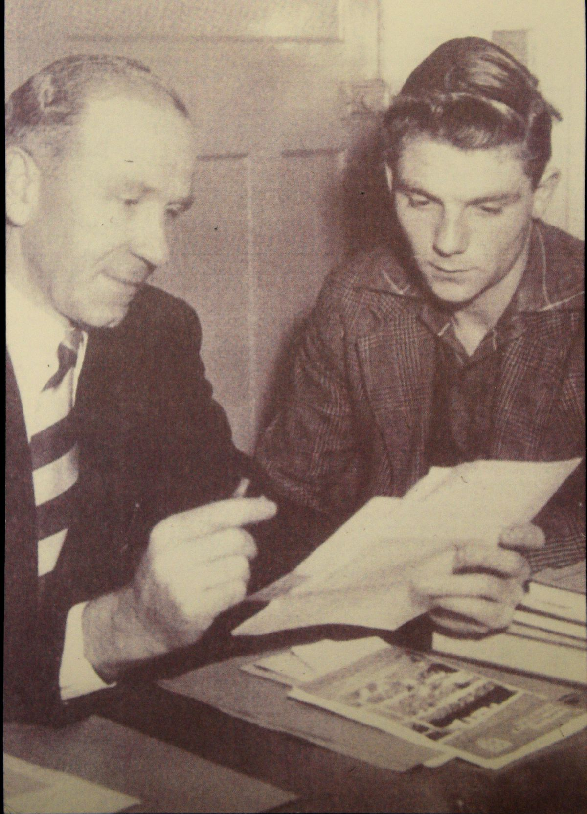 Duncan signing for Manchester United with Matt Busby