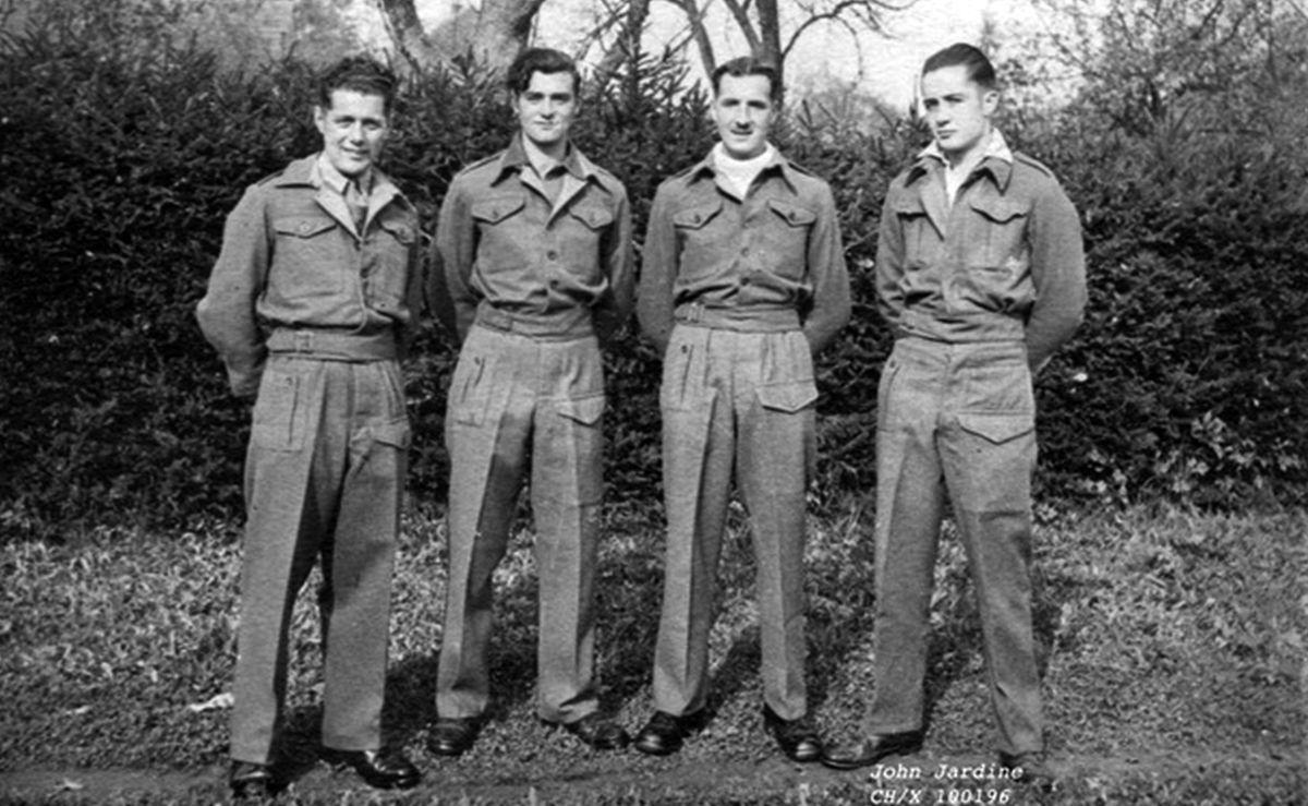 Jack Jardine, right, with fellow prisoners.