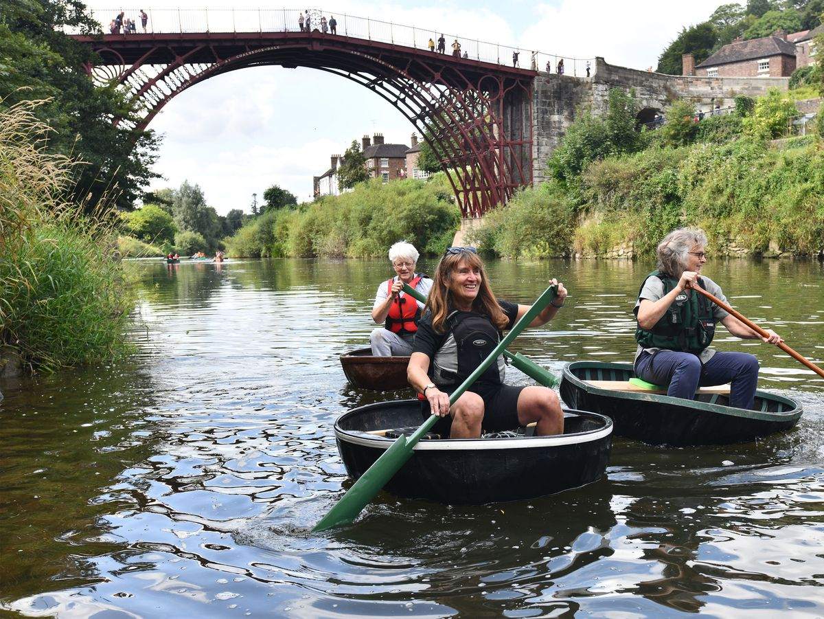 Ironbridge Coracle Trust ladies getting some last minute practice on the River Severn ready for the Bank Holiday Coracle Regatta, from left: Jude Pilgrim, Marion Blockley and Julia Tinker. Photo: Dave Bagnall