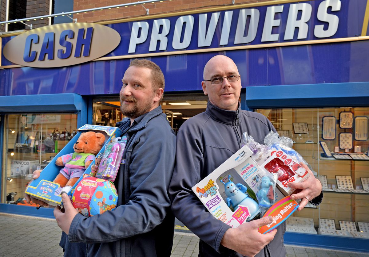 Raising money for children's Christmas gifts are Steve Simpson, left, and David Ford of Cash Providers in Wellington