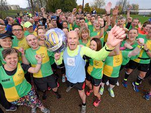 Jim Hussey celebrates his 80th birthday during the Telford Park run