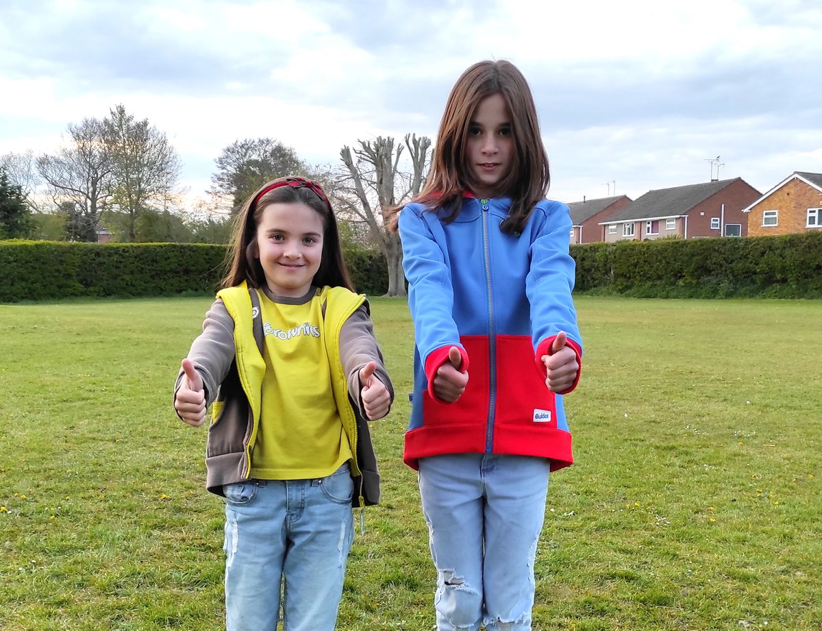 Sisters Emily (eight) and Jasmine Green (11) give the return to guiding a thumbs up