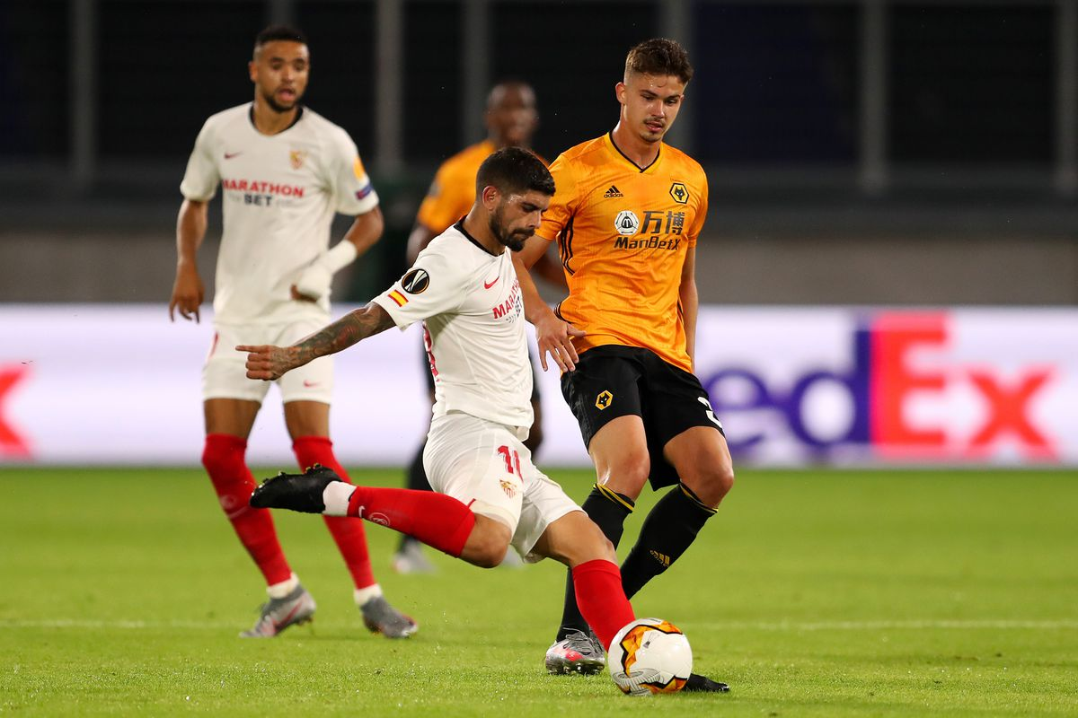 Ever Banega of Seville competes with Leander Dendoncker of Wolverhampton Wanderers (AMA)