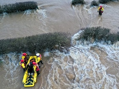 Motorcyclist rescued from swirling flood water in dramatic rescue