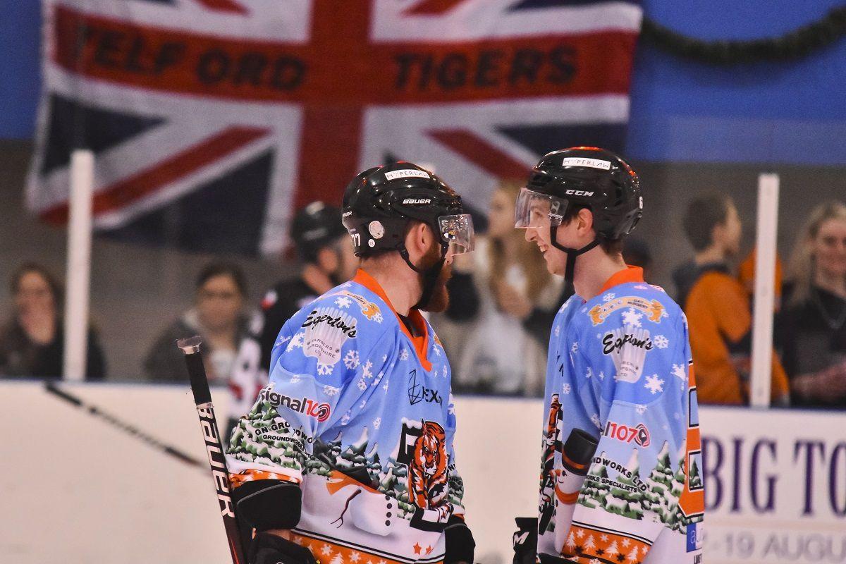 Scott McKenzie and Adam Taylor Celebrate a goal