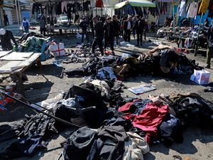 Security forces work at the site of a deadly bomb attack in Baghdad, Iraq