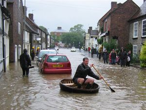 Flooding in High Street, Much Wenlock, on Monday, June 25, 2007, – Much Wenlock Town Councillor, Simon Ross in his Coracle in Much Wenlock High Street. Picture: Howard Horsley