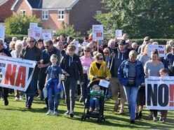 Hundreds join protest over recycling centre - with pictures and video