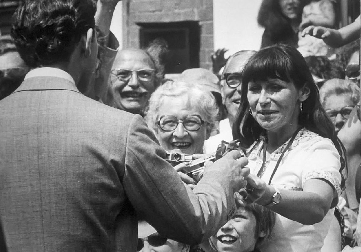 Anita Littler from High Ercall, Telford, gives Charles a rose moments before stealing a kiss during his visit to Ironbridge in 1979