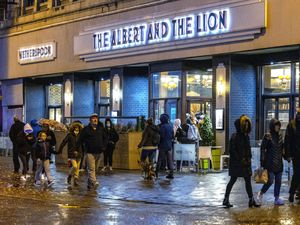 People outside a Wetherspoons pub in Blackpool