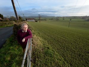 .Bruce Lawson,  who is leading the fight against a house being built in historic landscape looks across the land where permission has been granted