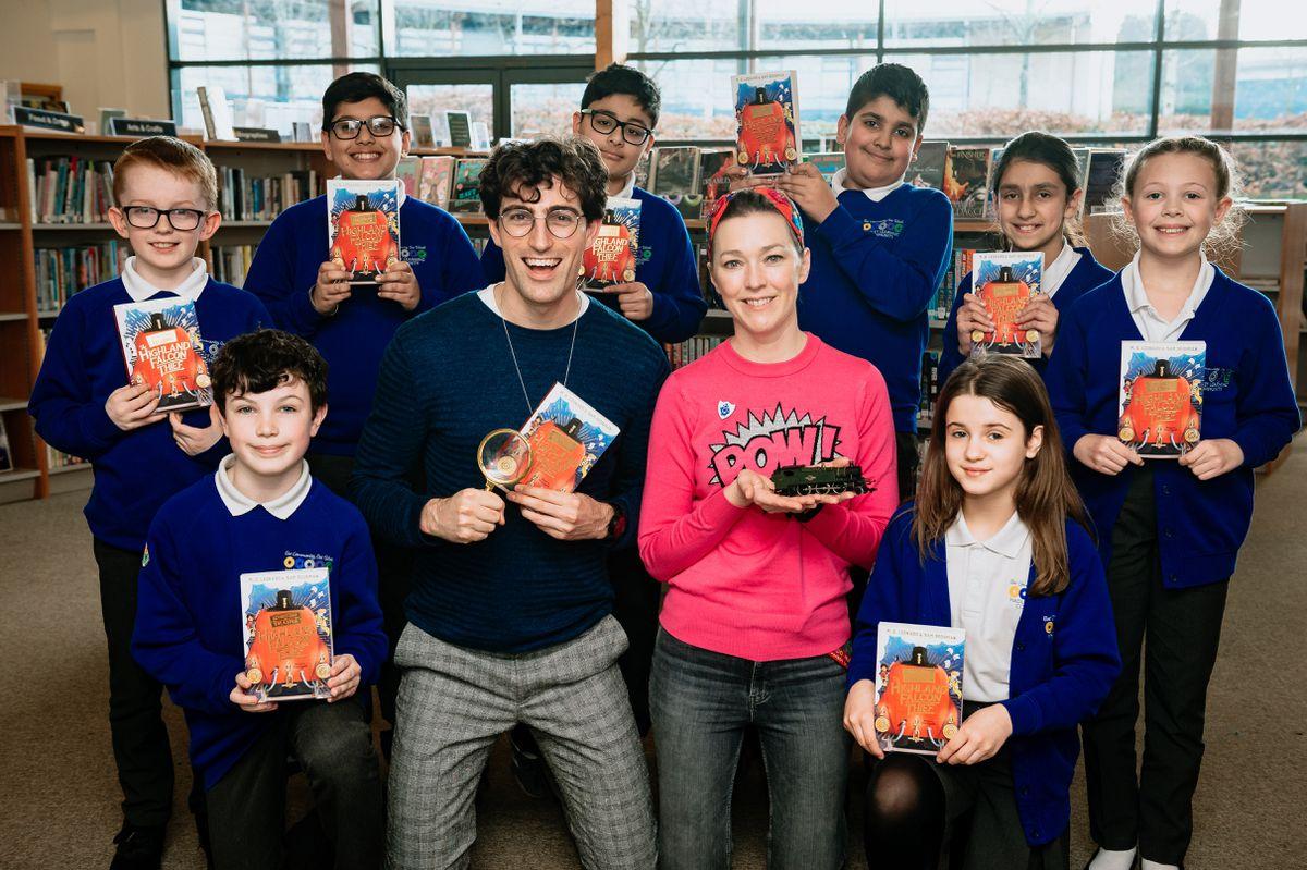 Authors Sam Sedgman and M. G. Leonard with pupils at Hadley Learning Community