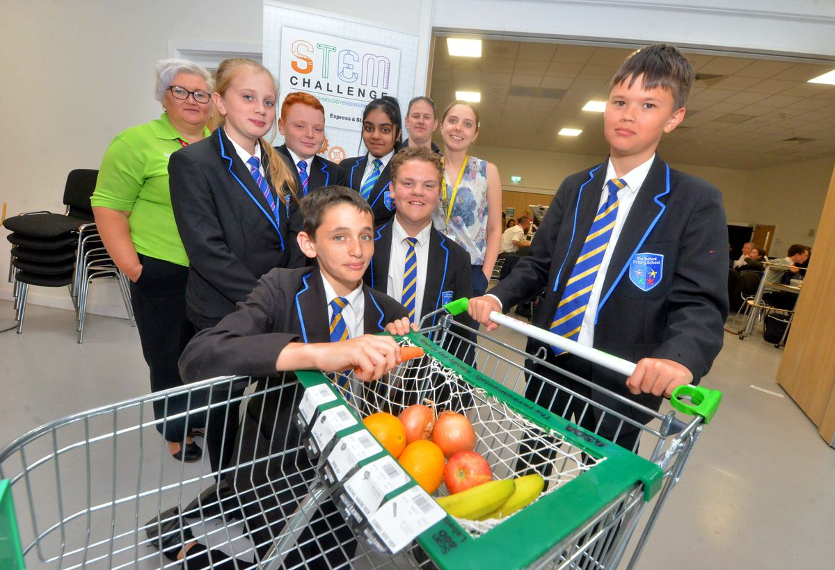 Telford Priory School with a design for a trolley to help with fruit etc meaning you don't use a plastic bag. June Walker from Asda, Eleanor Taylor-Cowley, 13, Lealan Hollis 13, Thomas Cooksey, 13, Suhavi Kaur, 13, Liam Francis, 13, mentor Tyron Carter from Epson, teacher Nikola Clarke, Harrison Craister, 13