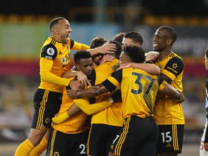 Raul Jimenez of Wolverhampton Wanderers is mobbed by teammates after scoring a goal to make it 1-0 (AMA)