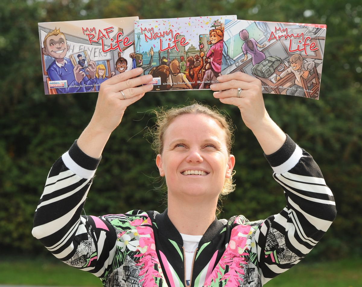 Children's author and military wife Donna David, of RAF Cosford, with the complete book collection