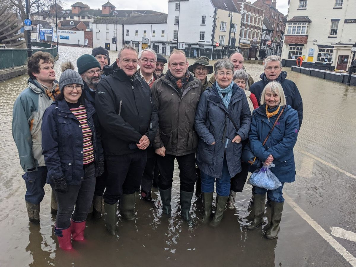 Ed Davey, Lib Dem leader with local councillors and supporters during the Shrewsbury floods