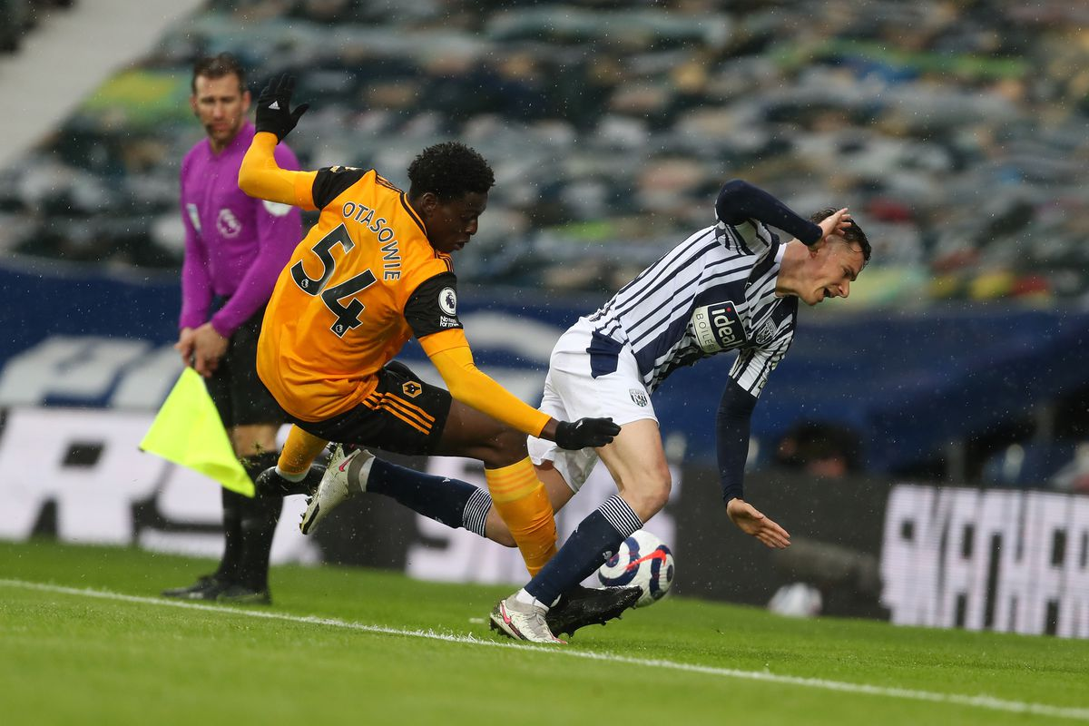 Owen Otasowie of Wolverhampton Wanderers and Conor Townsend of West Bromwich Albion. (AMA)
