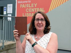 A librarian holds the returned book