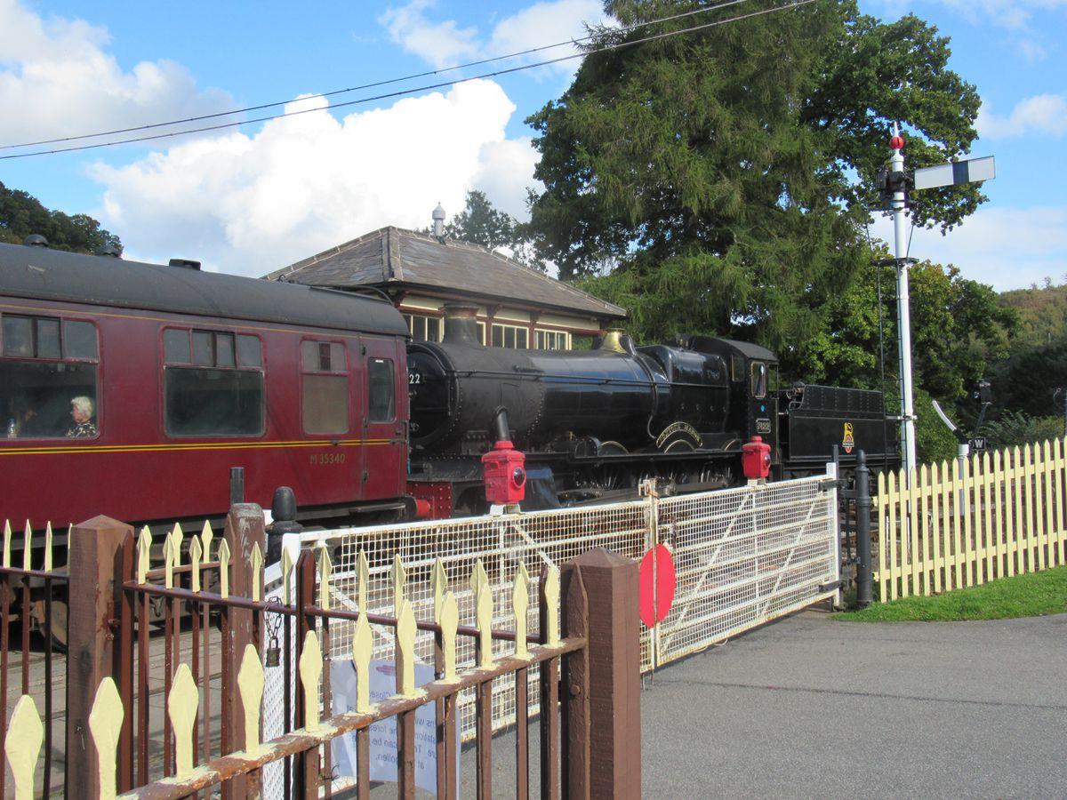 The penultimate train passes through Carrog station
