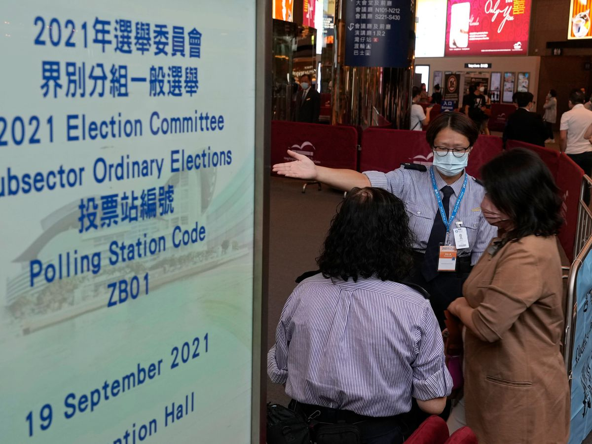 Voters enter a polling centre for the vote