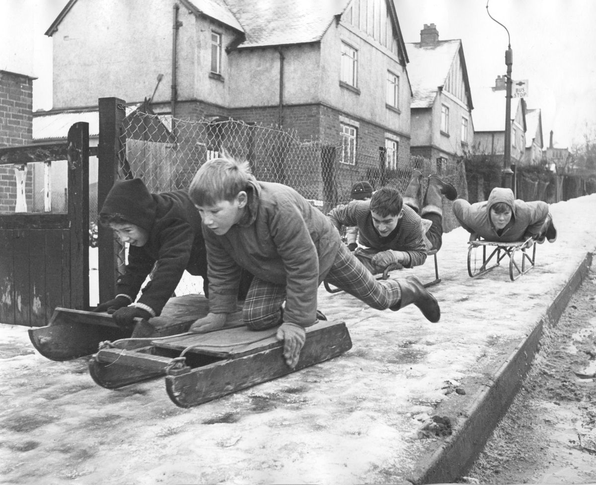 These youngsters were making the most of the snow on the steep pavements at the Hookfield, Bridgnorth, which proved ideal for tobogganing. This picture was first published on December 30, 1964.