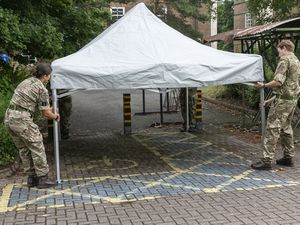 The reservists work on setting up the mobile unit