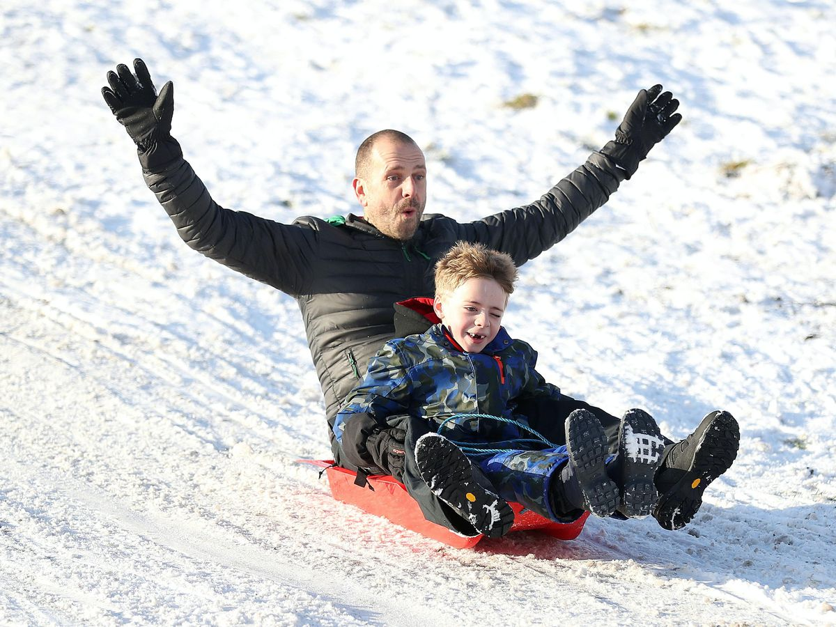 Dave Armitage and his son Brodie enjoy sledging in Cheshire