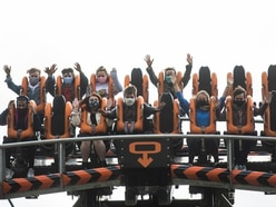 Alton Towers offers free return tickets after high winds cause rides to close on opening weekend