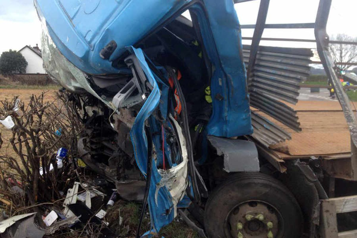 Explosion fear as driver trapped after two lorries crash on the A483