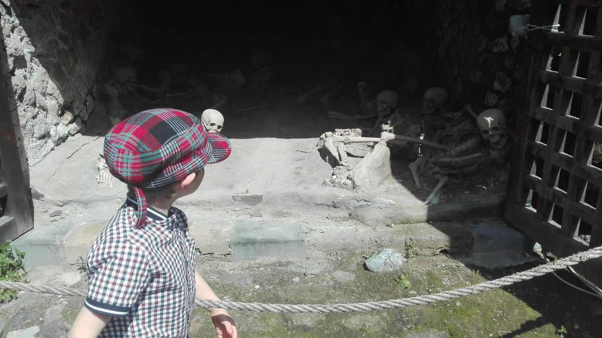 Harrison checks out the skeletons in Pompeii