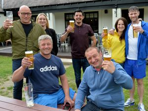 Regulars raise a glass at The Wild Pig pub in Meole Brace, Shrewsbury