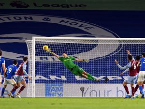 """Aston Villa goalkeeper Emiliano Martinez makes a save during the Premier League match at the AMEX Stadium, Brighton. Picture date: Saturday February 13, 2021. PA Photo. See PA story SOCCER Brighton. Photo credit should read: Neil Hall/PA Wire. RESTRICTIONS: EDITORIAL USE ONLY No use with unauthorised audio, video, data, fixture lists, club/league logos or """"live"""" services. Online in-match use limited to 120 images, no video emulation. No use in betting, games or single club/league/player publications."""