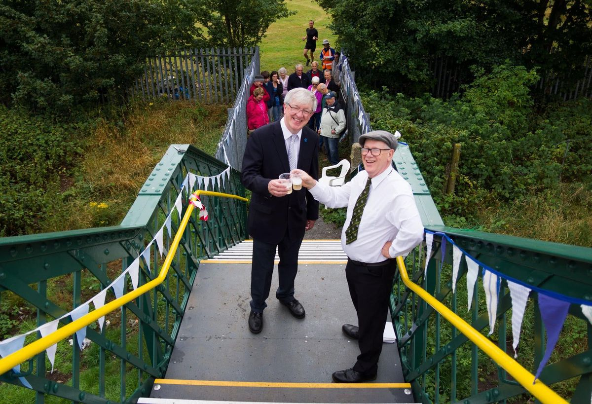 Phil Gillam and railway enthusiast David Giddins at the reopening of the footbridge