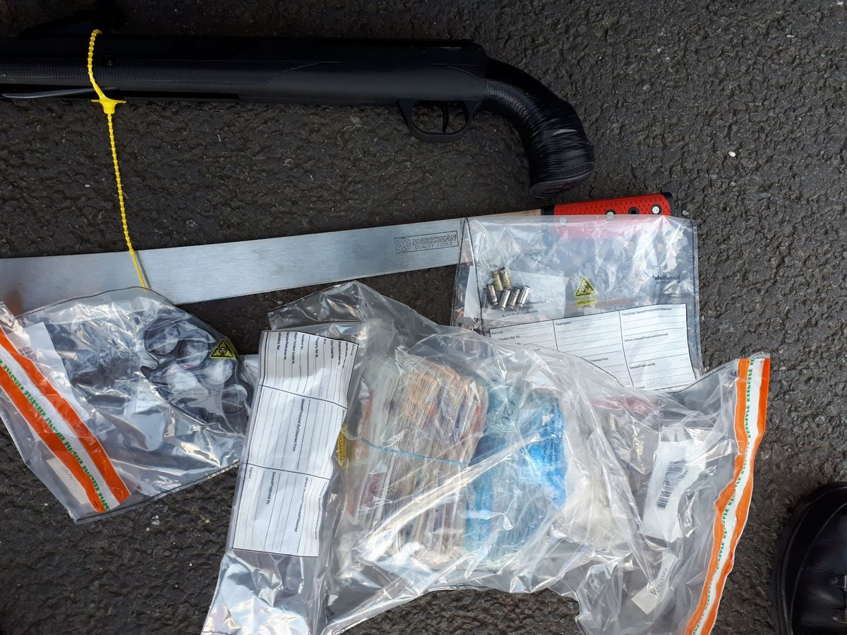 A gun and money found by police