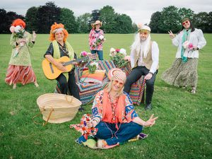 Members of RJAH staff donning their best sixties outfits in preparation for Festival on the Field