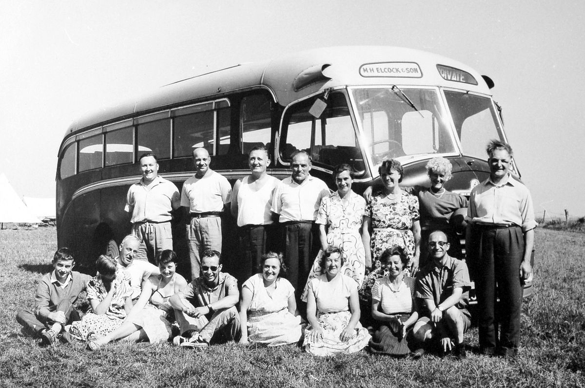 The annual camp of 2nd Oakengates Boys' Brigade, which was a joint camp with Clacton Boys' Brigade, at Sheringham, Norfolk, in 1959. These are the leaders, with an Elcock's coach in the background. Back, from left: Geoff Jones, Les Saunders, Jack Jones, Norman Jones (coach driver), Mrs Leighton (from Clacton), Doris Davies, Enid Jones, Wilf Davies.Front, first two unknown from Clacton, with grey hair is John Irving who used to be the youth leader in Oakengates and founded Oakengates Youth Club before the war, next two unknown from Clacton, Marjorie Saunders, Lily Jones, Gwen Tanner, and Harold Tanner (captain of Oakengates BB).
