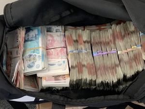 Some of the cash seized. Screengrab: West Midlands Regional Organised Crime Unit