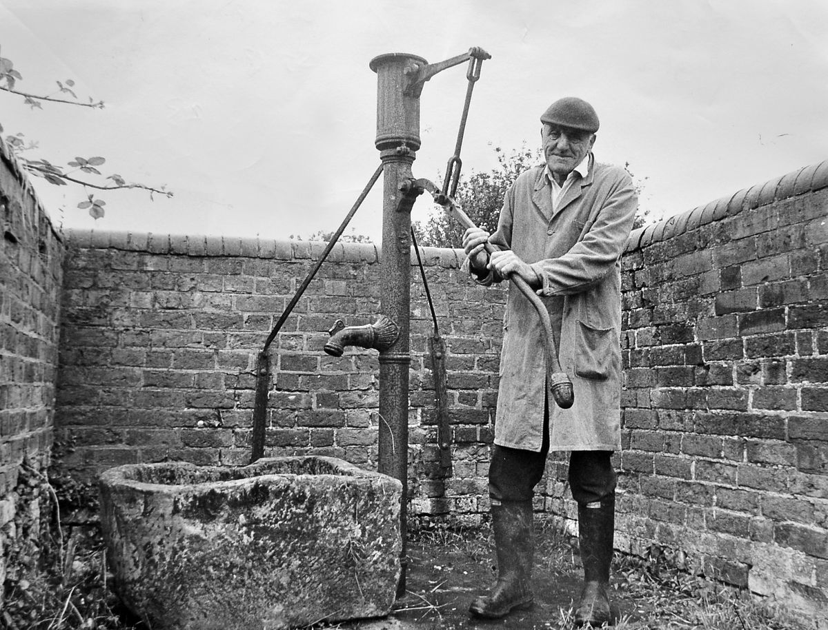 Bill Powis, 69, of Grove Farm, Berrington, could remember when he was a lad everybody relied on the village pump for water, making it a  meeting place, and a focal point at which the 140 children at the village school used to gather to eat their lunch. With the coming of piped water it was allowed to become derelict. But then Atcham Rural District Council handed over the pump to the parish and Mr Powis, pictured here in summer 1973, put it into something like working order, although it no longer pumped water.