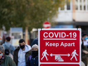Cocid-19 signage on High Street in Leicester, ahead of a national lockdown for England from Thursday. PA Photo. Picture date: Monday November 2 2020. See PA story HEALTH Coronavirus. Photo credit should read: Joe Giddens/PA Wire.