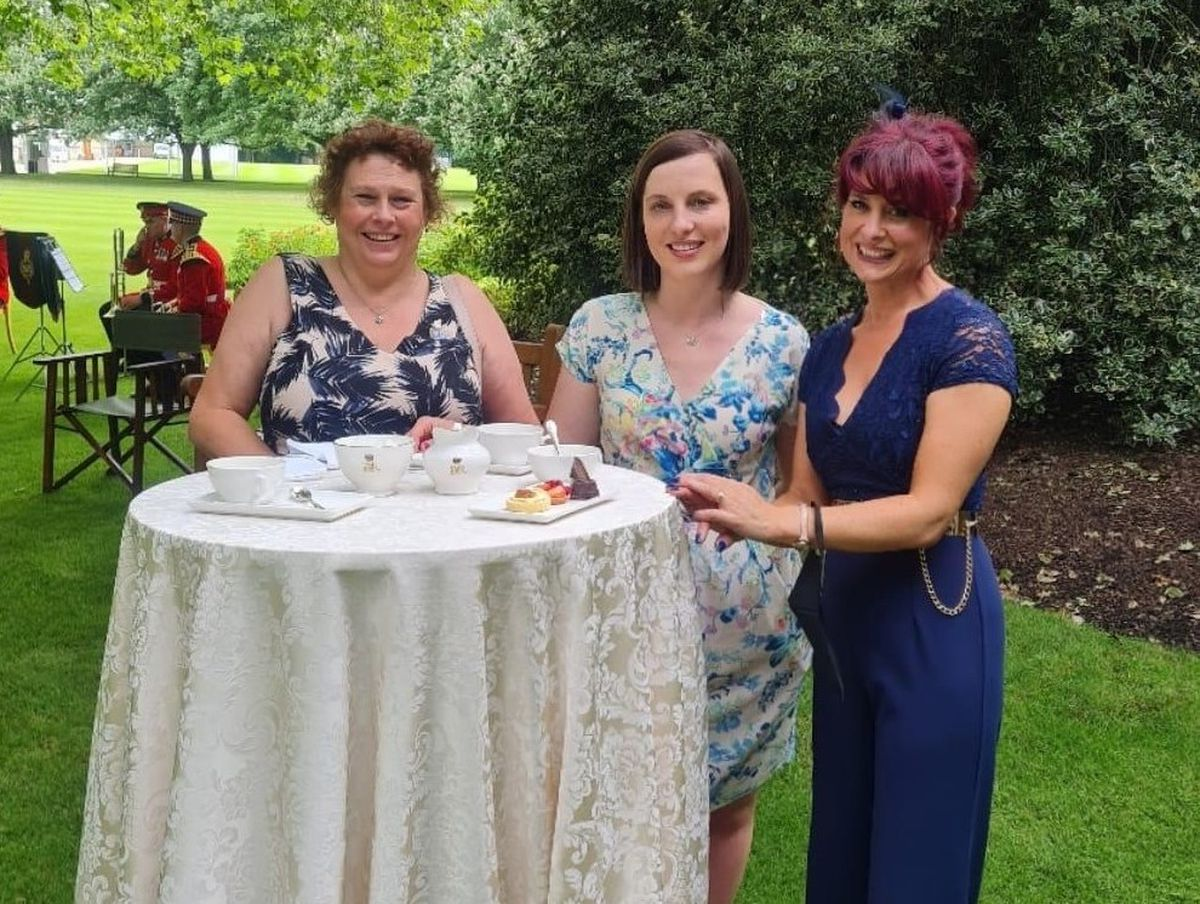Ronnie Taylor, Healthcare Support Worker; Joely Heighway, Occupational Therapist; and Hayley Gingell, Infection Prevention Control Governance Lead in Buckingham Palace Gardens