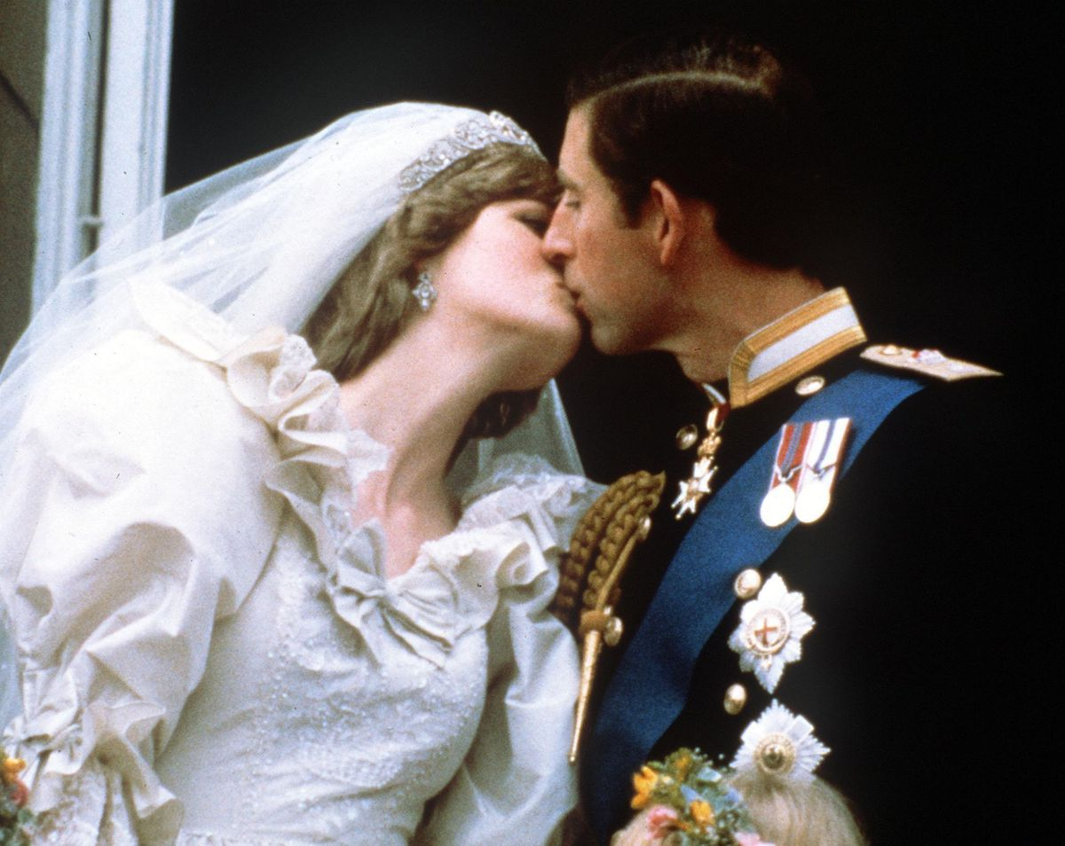 The newly-married Prince and Princess of Wales (formerly Lady Diana Spencer) kissing on the balcony of Buckingham Palace after their wedding ceremony at St. Paul's cathedral