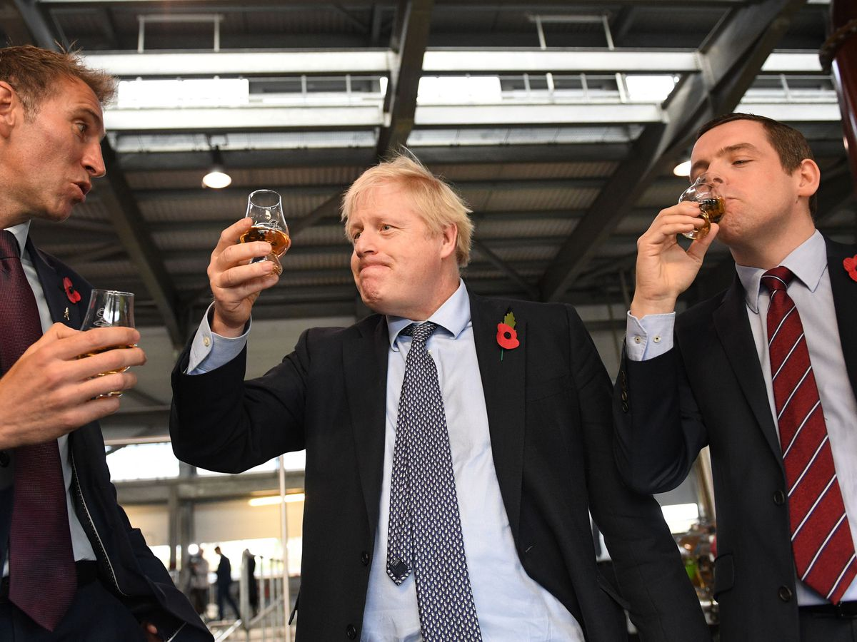 Scottish Tory leader Douglas Ross (right) and Prime Minister Boris Johnson (centre)