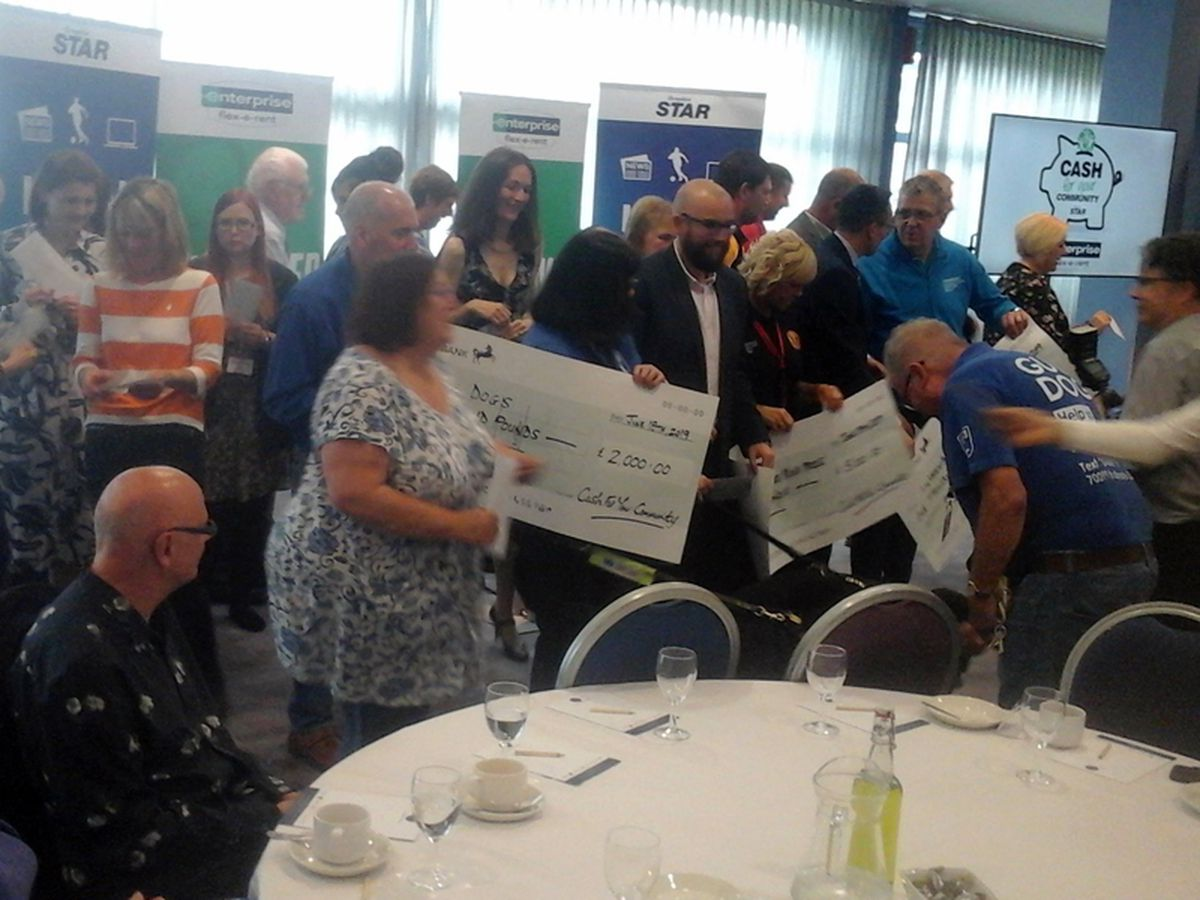 Some of the winners with their giant cheques