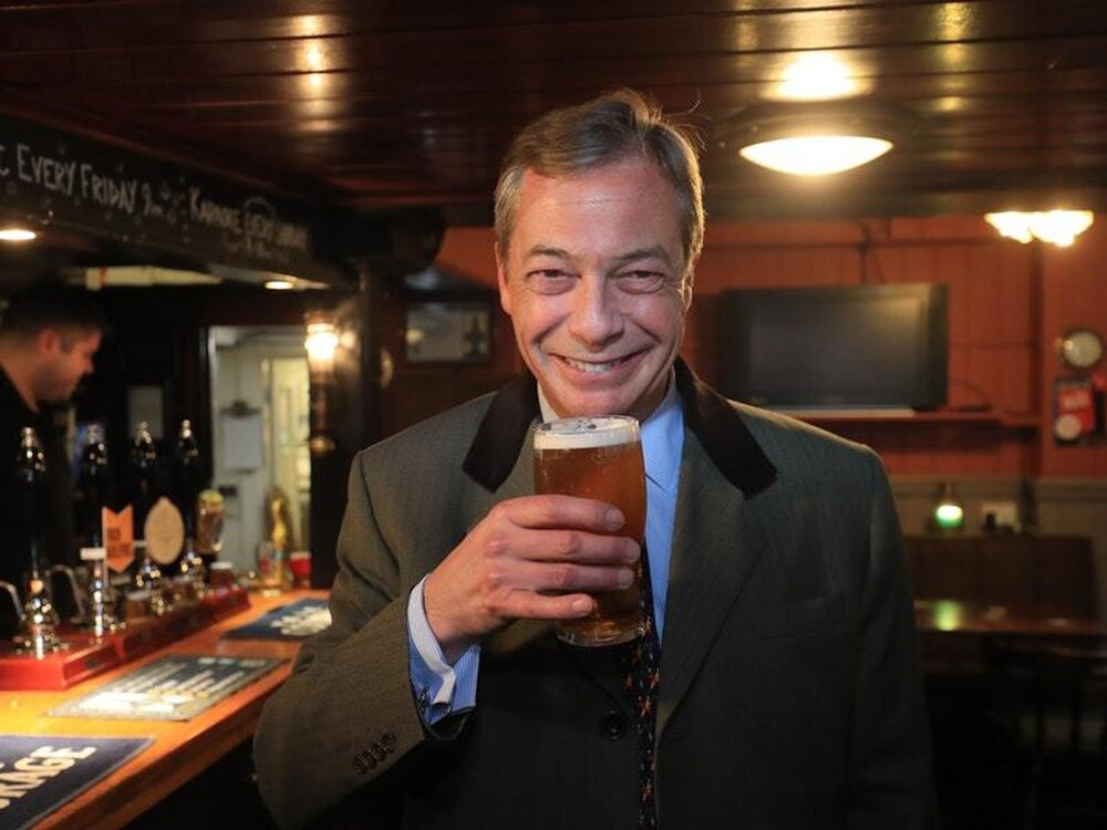 Nigel Farage enjoys a pint in Shoreham West Sussex during a walkabout ahead of a Brexit Party rally